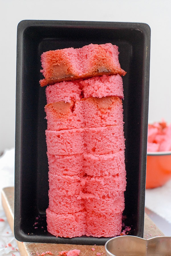 pink pound cake hearts in a loaf pan