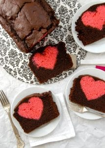 Hidden Heart Valentine's Pound Cake. Chocolate loaf cake with a cherry pound cake heart hidden in the middle! - BoulderLocavore.com