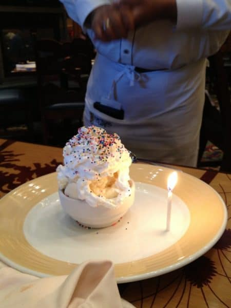 We enjoyed an excellen dining experience at the Storyteller Cafe {Grand Californian Hotel - Disneyland}. The chef walked us through the entire menu and returned at the end of the meal with this gluten-free birthday bowl of ice cream 'with extra sprinkles' for our birthday boy.