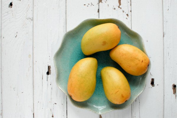 Ataulfo or Champagne mangos. Grown primarily in Mexico they are smaller than the more familiar mango variety however with a thinner pit and no fibers are able to yield more meat with less effort.