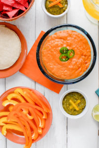 Sliced bell peppers, Chile con Queso and Roasted Jalapeno Salsa with chips