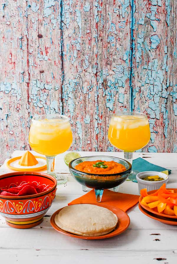 Chile con Queso, Roasted Jalapeno Salsa, corn tortillas, red chips and peach margaritas
