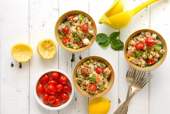 Rainbow Quinoa Summer Salad. This colorful chilled salad recipe is packed with nutrition and fresh flavors of summer. It can be prepared in less than 30 minutes (with a bit more time for chilling) and is perfect with grilled meats or for a quick, light bite anytime! - BoulderLocavore.com