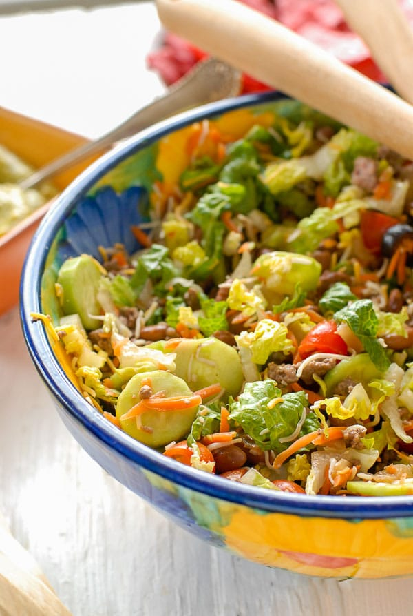 Large bowl of Taco Salad Ole with Avocado Tequila Lime Dressing