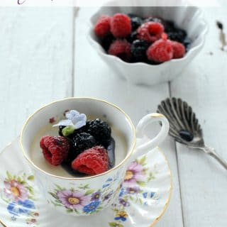 Teacup Panna Cotta with Berries in Creme de Violette syrup side view