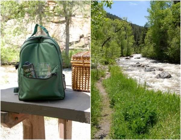 picnic table with backpack and river