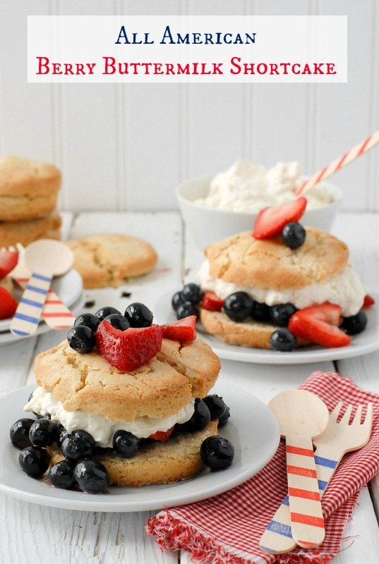 Freshly baked All American Berry Buttermilk Shortcakes with fresh blueberries and strawberries on white plates with patriotic wooden spoons - BoulderLocavore.com