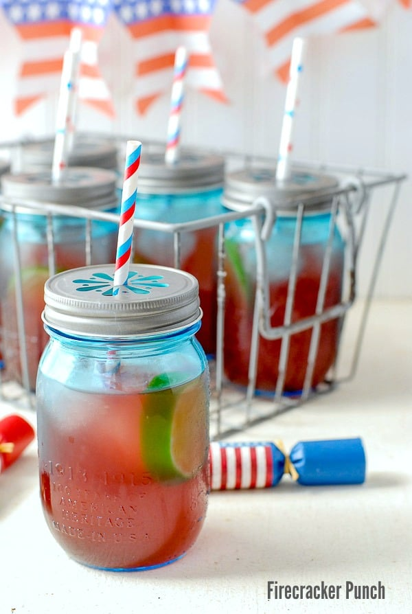 Firecracker Punch (Fourth of July punch recipe) in blue jars with straws