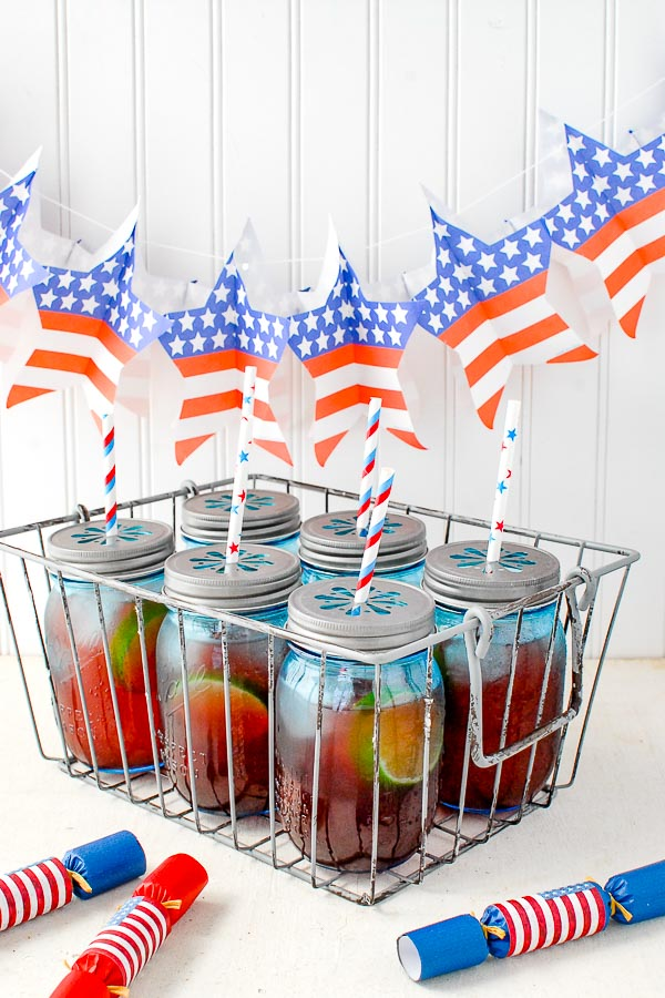 Basket of blue jars filled with Firecracker Punch