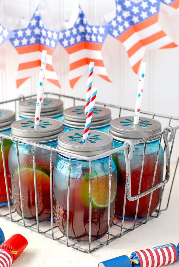 Blue jars of Firecracker Punch recipe for Fourth of July