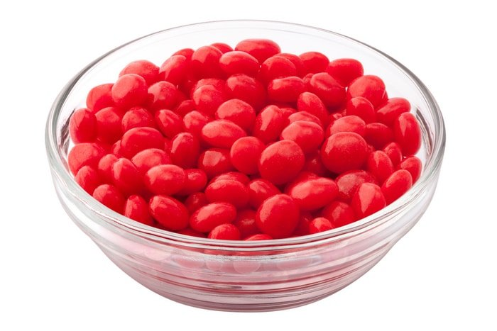 clear bowl of Red Hots candy