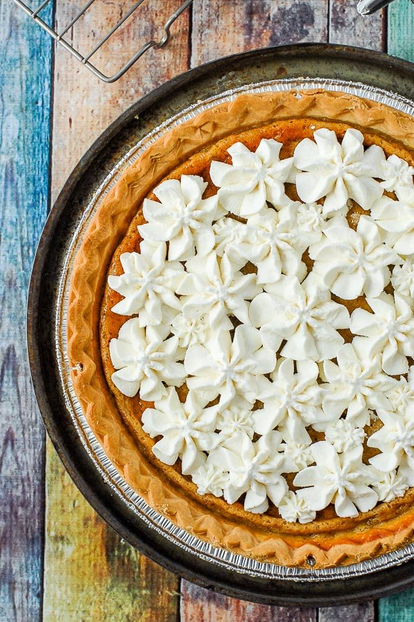 Whipped cream topped Sour Cream Raisin Pie
