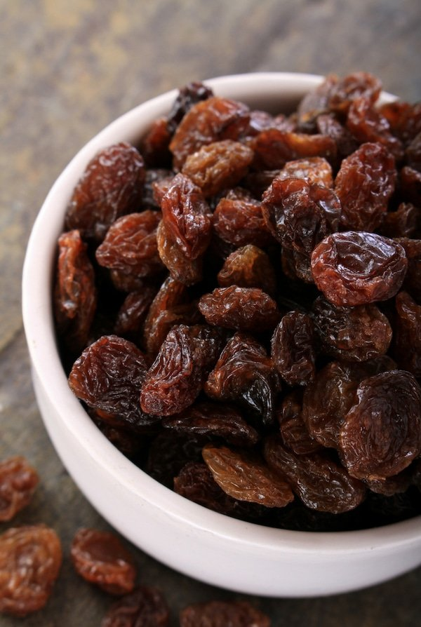 white bowl of raisins