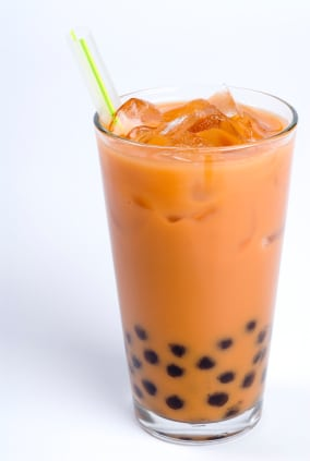 Glass of black tea with cream and tapioca