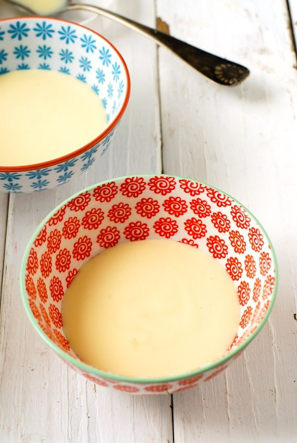 Lemony Snow Pudding with Rose Custard Sauce. A light, airy lemon meringue 'snow pudding' with rose-flavored custard sauce. It's dreamy! - BoulderLocavore.com