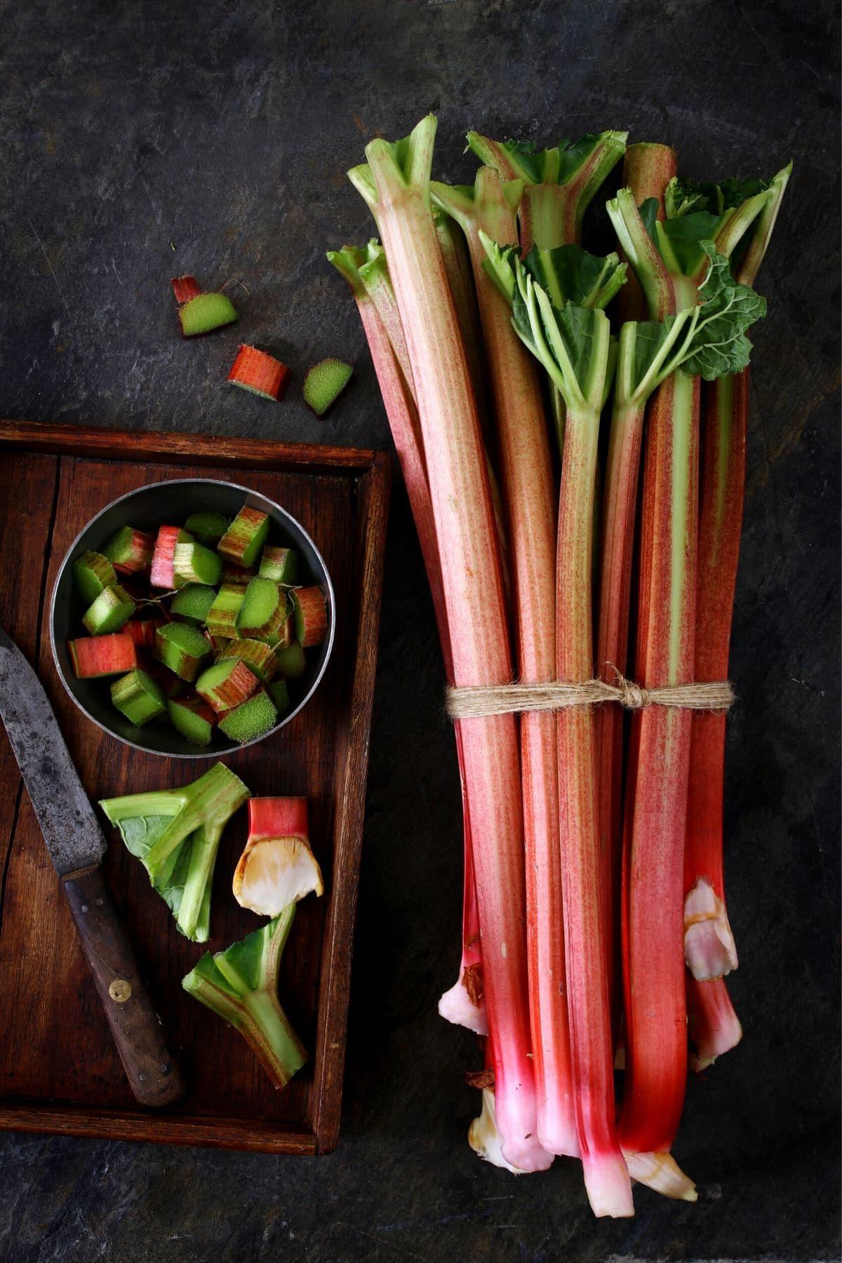 stalks of rhubarb and sliced rhubarb