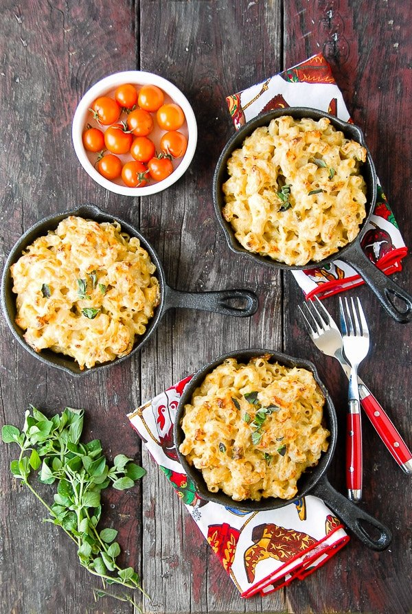 Creamy Roasted Green Chile Chicken Mac and Cheese in skillets with forks