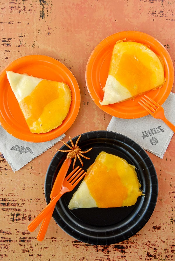 Three Candy Corn chicken quesadillas on halloween plates