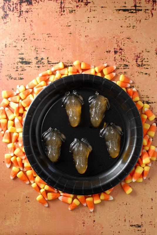 Glowing Candy Corn Vodka Jello Shots shaped like frogs