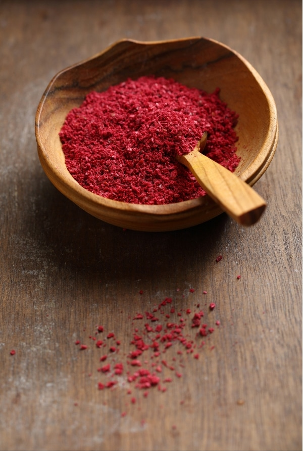Ground Sumac in wooden bowl