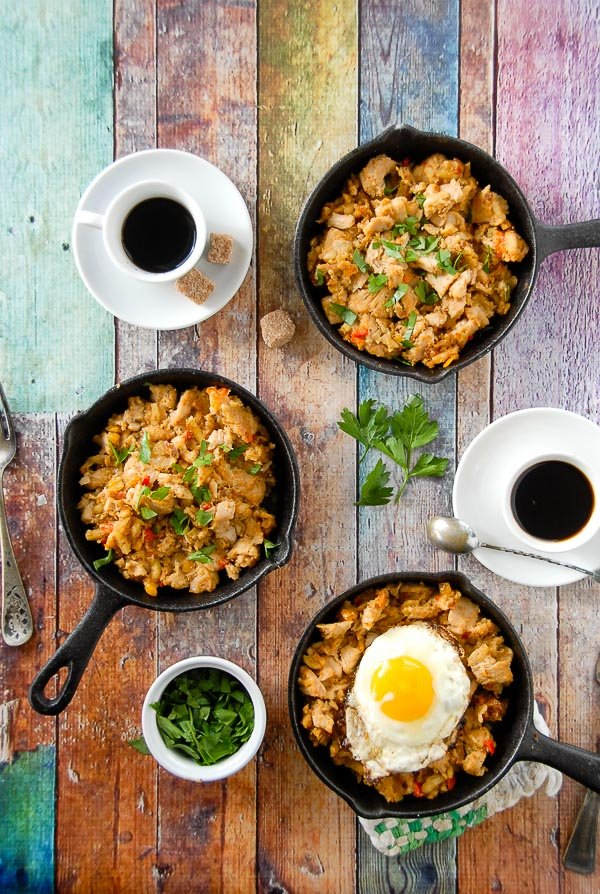 three mini skillets of holiday turkey hash with fried egg