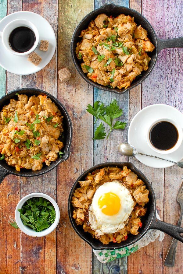 three skillets of holiday turkey hash with espresso cups