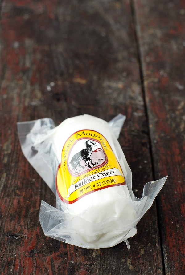 package of goat cheese on wood surface