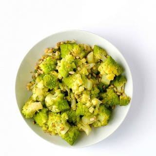Lemony Romanesco with Pine Nuts. A fast healthy side dish recipe for spring or fall, Romanesco adds a light flavor to any meal. Gluten-free recipe. - BoulderLocavore.com