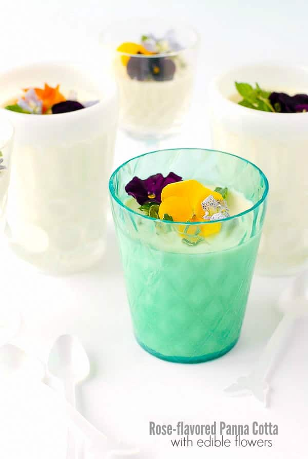 Fresh and quick to make Rose-flavored Panna Cotta with edible flowers in a blue quilted glass with Sabre mini butterfly spoons BoulderLocavore.com
