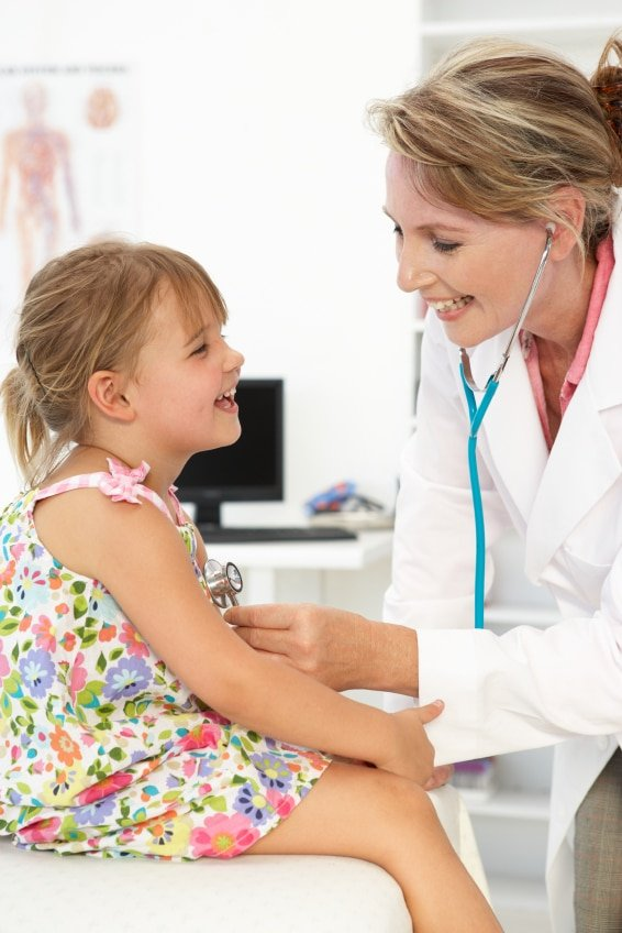 Female doctor examining child | BoulderLocavore.com