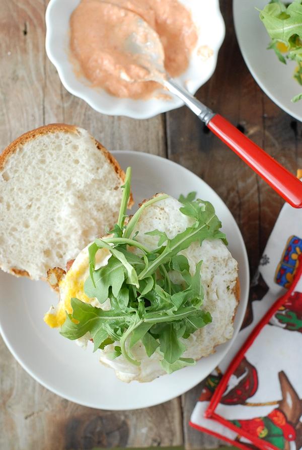 Juicy Bacon-and-Egg cheese Breakfast Burger - arugula - BoulderLocavore