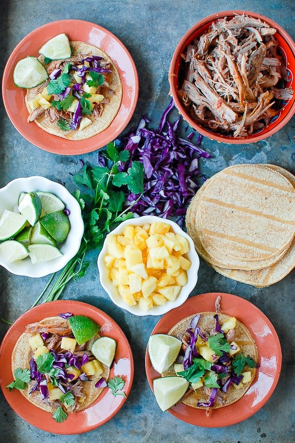Plates of Tacos Al Pastor and extra ingredients