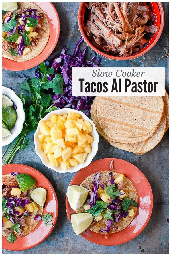 Tacos Al Pastor on small plates with pineapple chunks