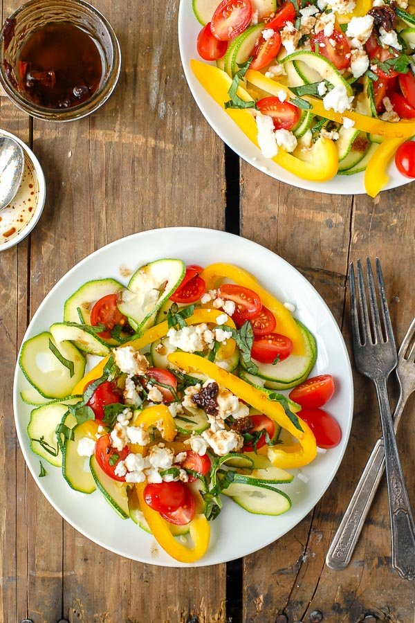 plate of Mediterranean Salad with zucchini ribbons and sun-dried tomato balsamic vinaigrette