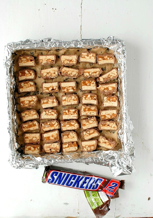Cookie Dough Snickers Brownies - Snickers slices -  BoulderLocavore.com