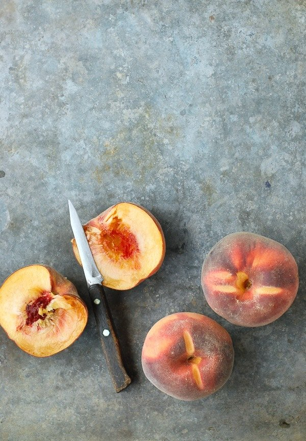 Fresh Peaches halved with knife