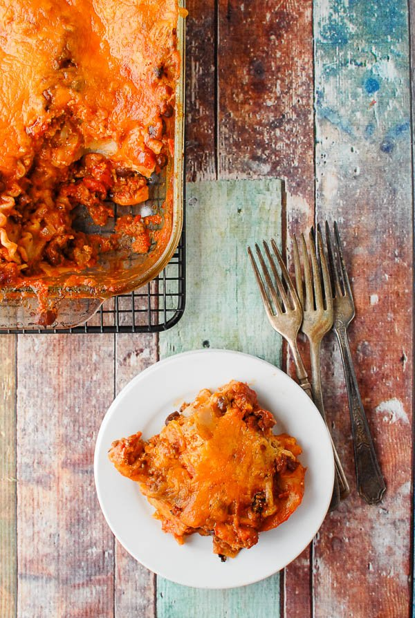 Mexican Lasagna serving on plate with lasagna pan
