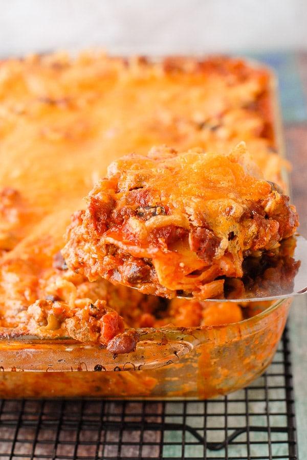 Mexican Lasagna serving on spatula