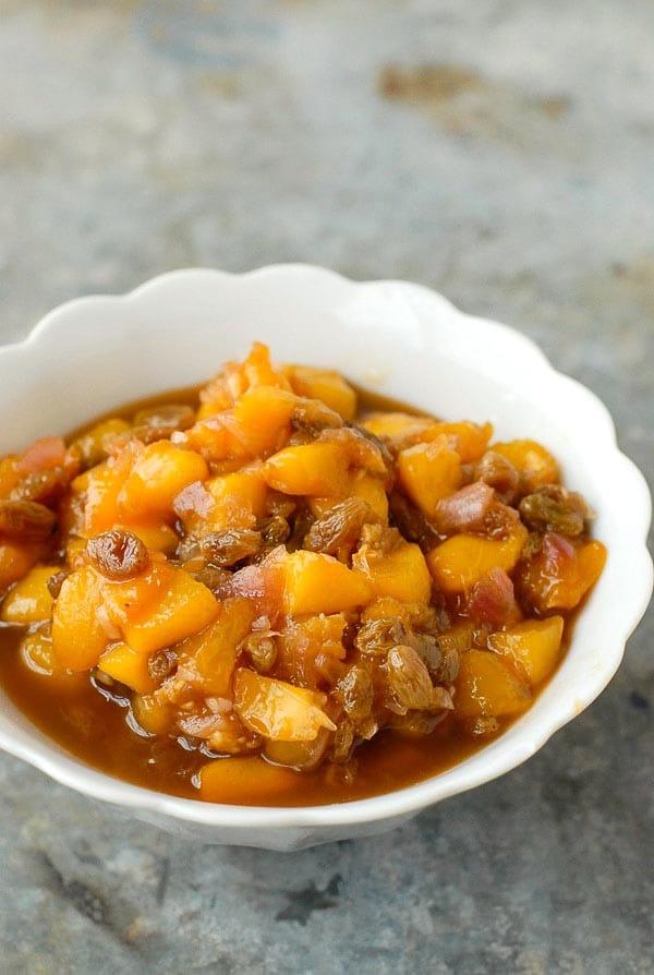 white bowl of peach chutney
