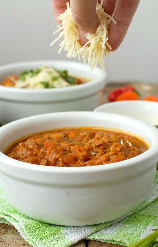 Pumpkin White Bean Chili and grated cheese | BoulderLocavore.com