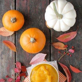 Homemade Pumpkin Puree with pumpkins and leaves