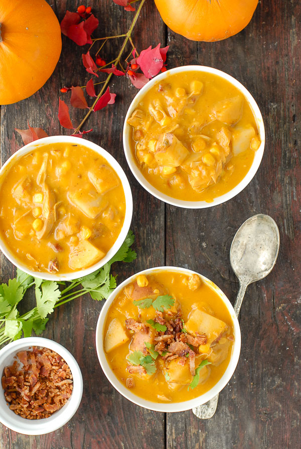 three white bowls of slow cooker spicy pumpkin corn chowder