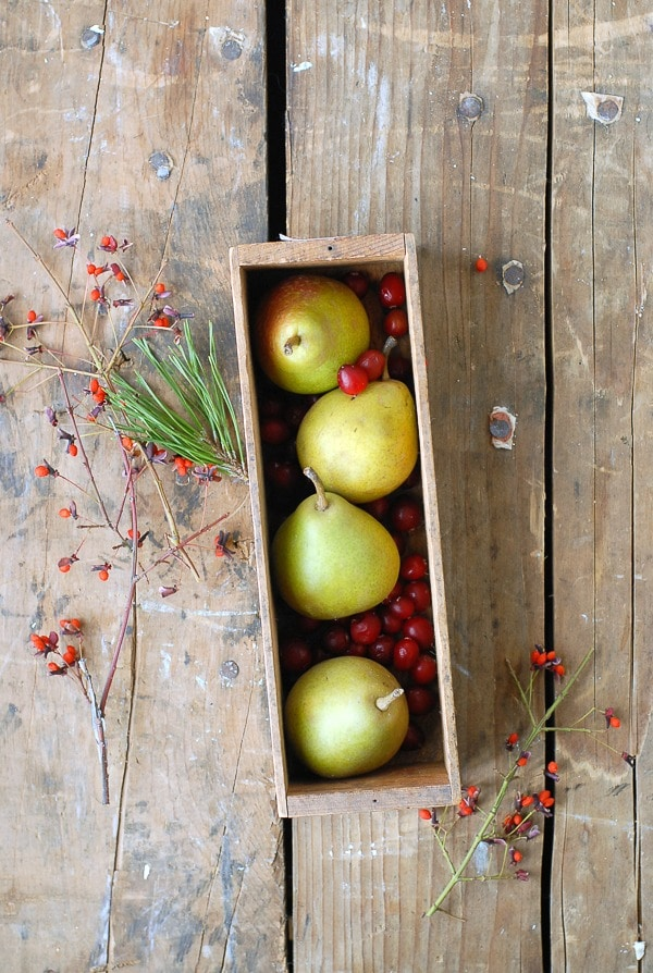Pears and Cranberries in vintage cheese box with fall foliage  - BoulderLocavore.com