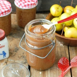 Slow Cooker Pennsylvania Dutch Spiced Apple Butter in jar with spoon