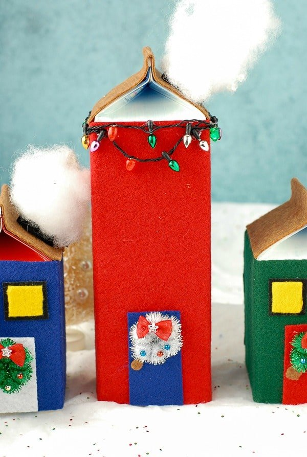 Tall skinny House with lights  DIY Milk Carton Holiday Houses - BoulderLocavore.com