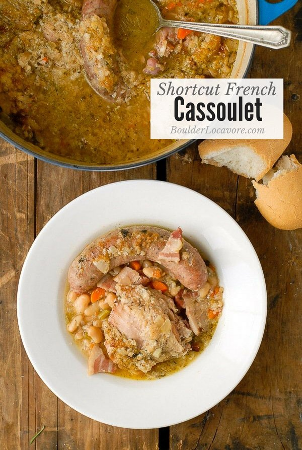 Cassoulet is an easy hearty French country stew made with white beans, chicken thighs, bacon, sausage and more. This Shortcut French Cassoulet version is ready within 2 hours (mostly cooking time). The garlic breadcrumb crust is the best (can be #glutenfree)! #stew #french #casserole #chicken #bacon #sausage #easydinner #easyrecipe #frenchrecipe #beans #comfortfood