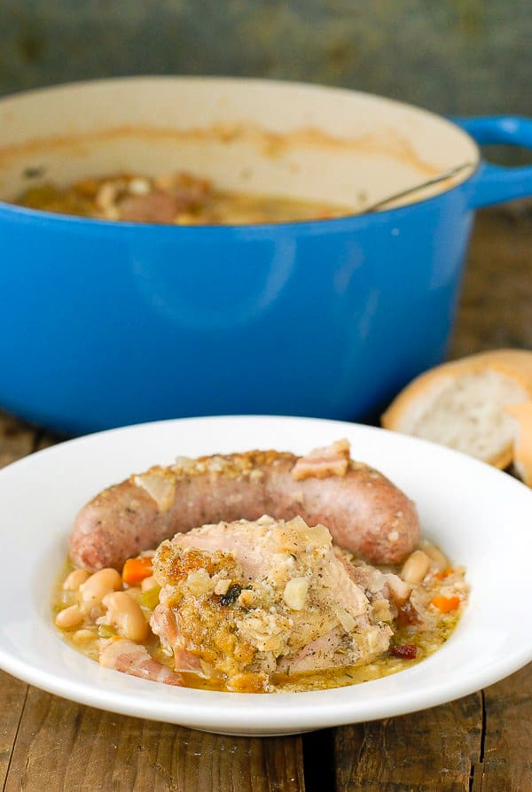 French Cassoulet stew wtih chicken and sausage in white bowl