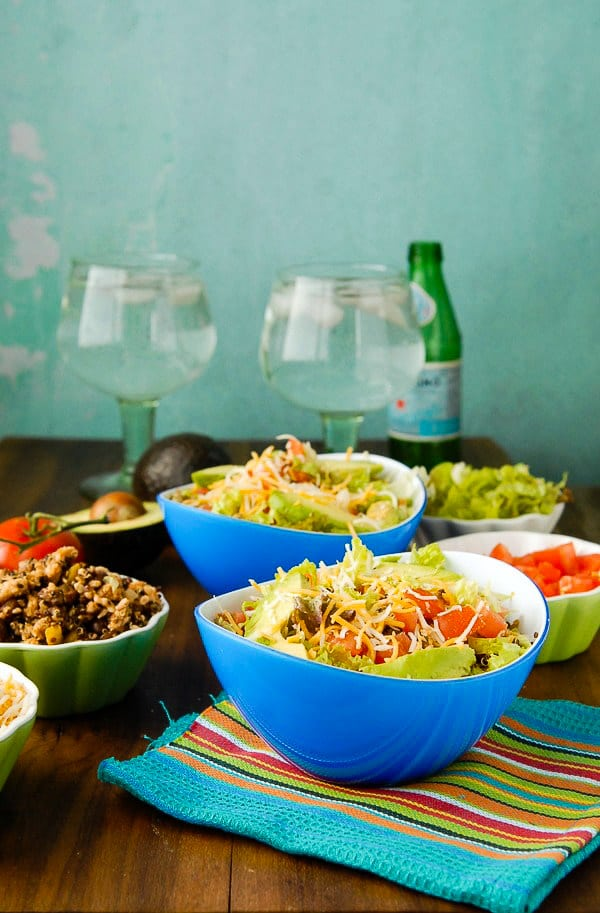 Hot off the stove Lean turkey black bean quinoa healthy burrito bowls with toppings, and green glass water goblets BoulderLocavore.com