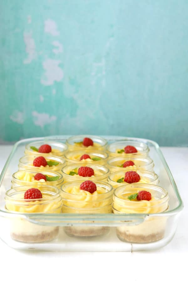 Clear baking pan filled with Mini Mascarpone Key Lime Curd Cheesecakes in Jars - BoulderLocavore.com
