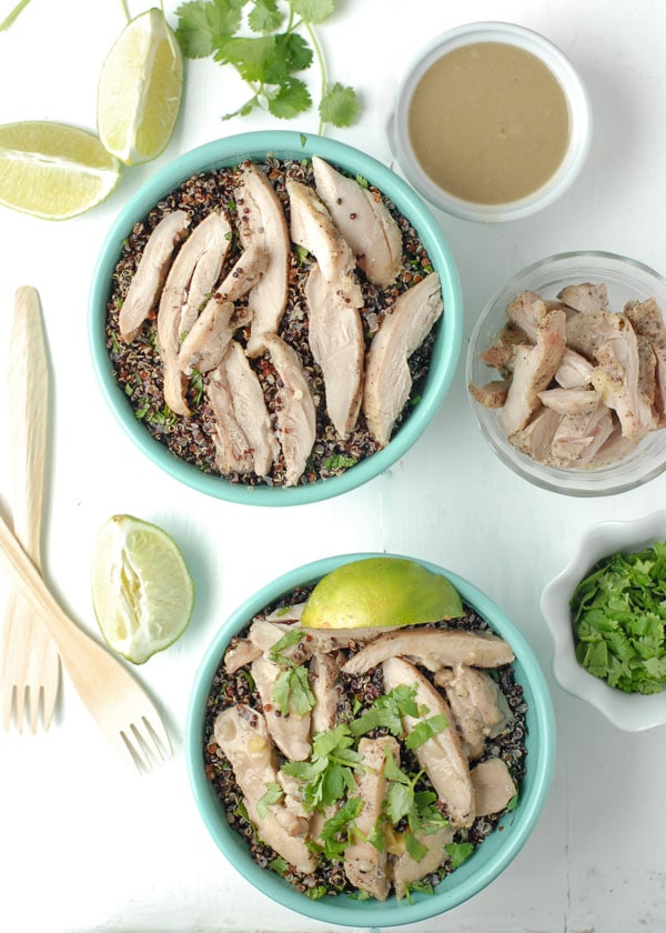 Thai Chicken Thigh Basil-Quinoa Bowl with lime wedges and fresh cilantro